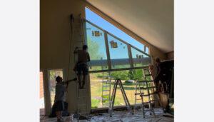 Voska_install-large-pella-window